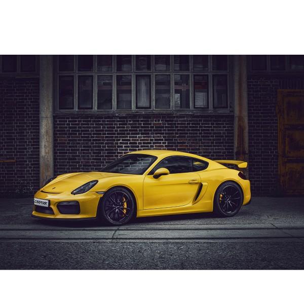 Porsche 911 gelb vor Ziegelwand