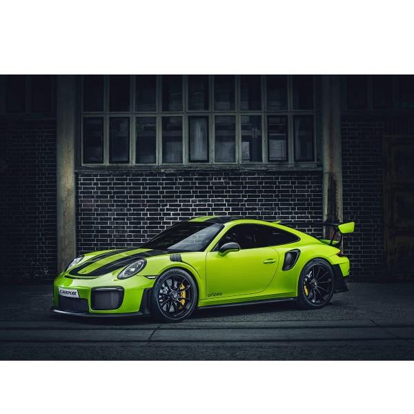 Porsche GT2 RS grün vor Ziegelwand